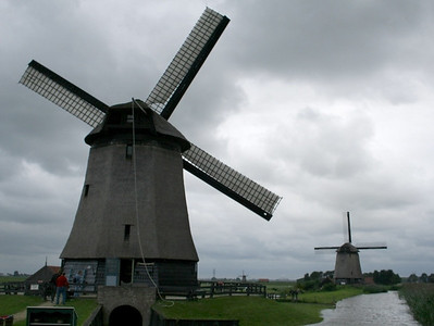 By now it was raining, we drove on and found a windmill museum which was open to the public. The mill had been kept in its original condition. This mill had  glass installed in the floor -  you could see the  big screw underneath churning up the water.  The power it was generating was enormous