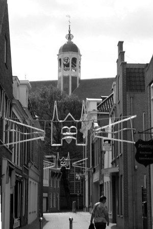 Looking up at the high dome of the Martinikerk dwarfed us far below in the street - black & white photo