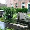 Liesbeth and I stood in this graveyard taking photos in the rain.