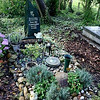 Another grave - I love the idea of using stones and growing plants over the gravesite - we don't see that in our local area, we use bland tombstones or a plaque with a rose.