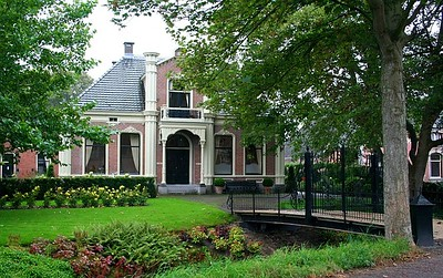 Another beautiful house and bridgeway - I love the way the Dutch open their windows up - let you see inside - they are such open people - they also love to decorate their windows.