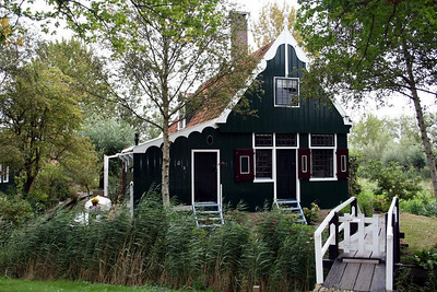 The freshly painted or tarred wooden houses, windmills, small factories and enterprises are all original. The paint is in various lovely shades of green. All buildings have been relocated from other areas in the Zaanstreek when modernization and urbanization threatened the unique buildings. They were kept for future generations and rebuilt in de Zaanse Schans in the 60's and 70's of the last century.