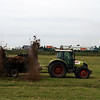 Tractor throwing out manure over the fields