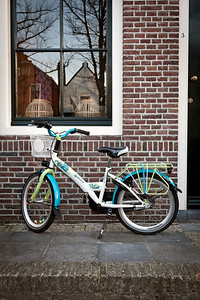 Bicycle waiting on its owner in front of house in small village Edam, North Holland, Netherlands