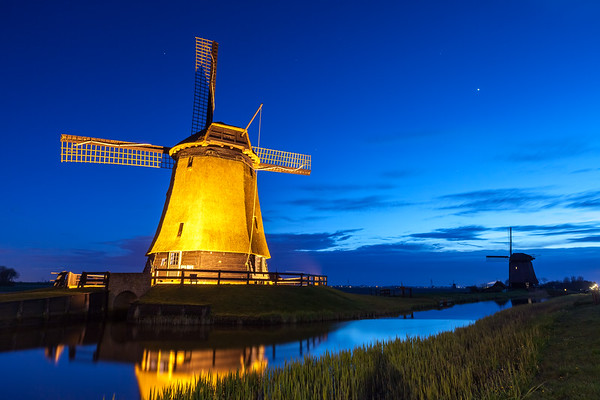Windmills at twilight near small village Schermerhorn, North Holland, Netherlands