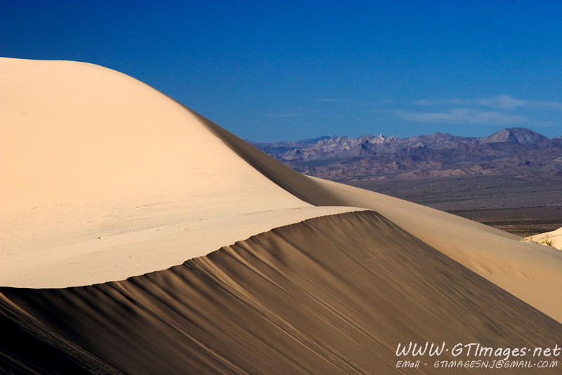 From the top of the sand dunes at Kelso, CA. I was standing on top of a 700ft dune, and was the only person for as far as the eye could see.
