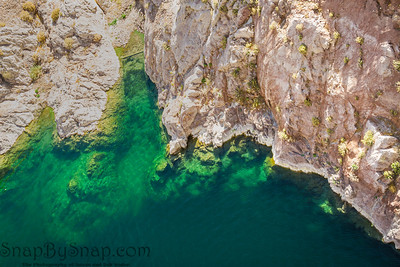 Aerial image looking down on the clear green waters of Lake Meade