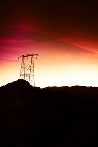 Energy concept image with electrical towers on a rocky landscape