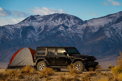 A campsite in the Nevada Wilderness with a tent and a Jeep