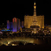 The Bellagio fountains and Paris Las Vegas at night. Las Vegas, Nevada, United States