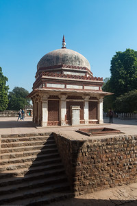 Imam Zamin's tomb. Qutb complex is an UNESCO World Heritage Site in the Mehrauli, Delhi, India. Structures are made of red sandstone and marble.