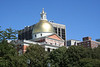 At the top of the golden dome sits a wooden pinecone which symbolizes logging in Boston during the 18th century.