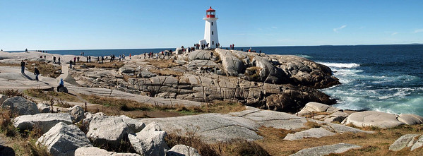 Lighthouse at Peggy's Cove. Near Halifax, Nova Scotia. The first lighthouse at Peggys Cove was built in 1868 and was a wooden house with a beacon on the roof.