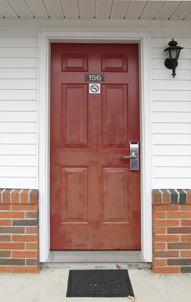 <h2>Red Door</h2>I started taking pictures of doors when I was in France several years ago with my wife.  This one was a simple motel room door.  This was our Econo Lodge door in Sturbridge, MA