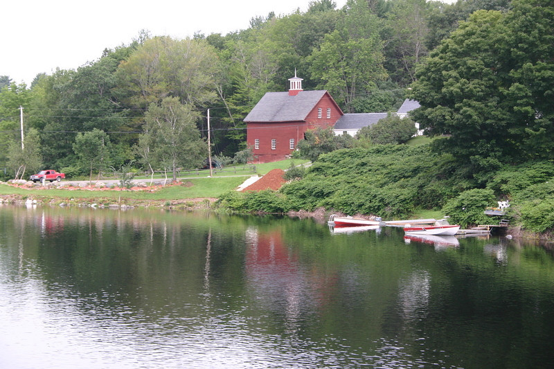 Red barn and boats