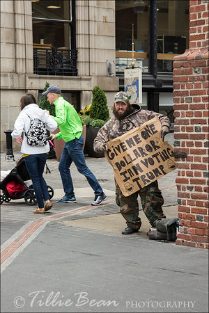 Beggar by the old State House