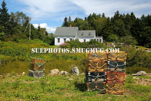 Lobster traps near a home in Cushing, Maine