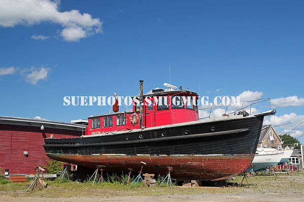 An old boat on land in the town of Belfast, Maine