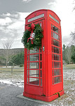 An old-fashioned British telephone booth decorated with a Christmas wreath, in the small town of Rowe, Massachusetts, United States