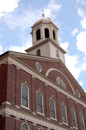The historic landmark Faneuil Hall on a bright sunny day in Boston, Massachusetts