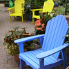 Colorful Adirondack chairs in a patio setting