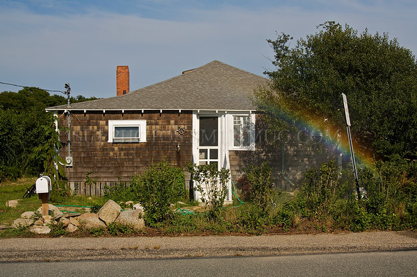 Rainbow in front of a small Cape Cod home