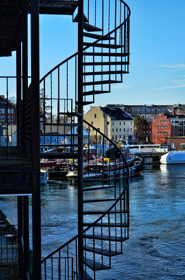 A spiral staircase leads down to the harbor area in Portsmouth, New Hampshire