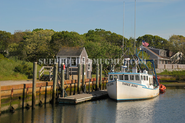 A fishing boat docked in Saquatucket Harbor, Harwich Port, Cape Cod, Massachusetts