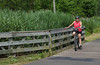 Riding through marshy area on Atlantic Highlands Trail