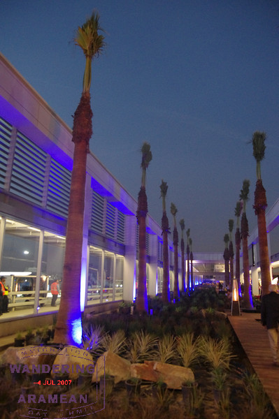 The open-air courtyard, lit up for the party at dusk