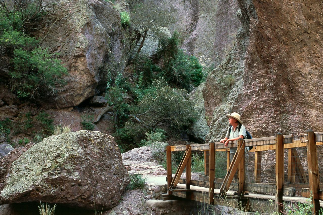 Rita admires the view from one of several bridges over Whitewater Creek.