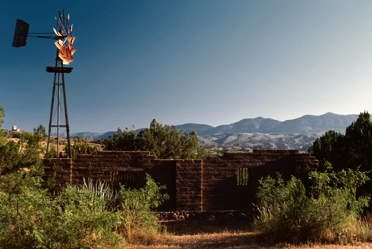 The adobe wall is fake, but the wind pump is real. Actually, the wall is real adobe, but aside from it's visual effect, I couldn't think of any reason for it to exist. The pump does work, and it's gentle metallic clanking could occasionally be heard from our cabin.