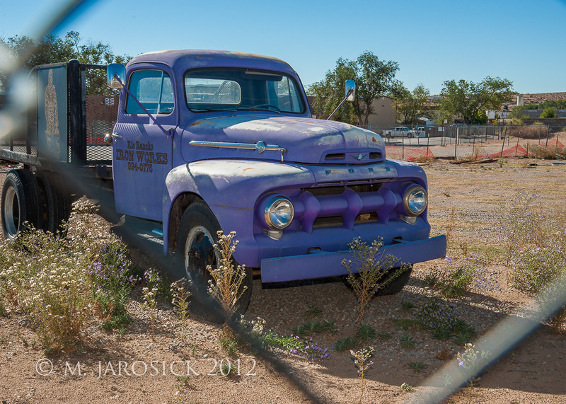 "Purple truck!  Mid-50's Ford survivor.  I was excited to find this opportunity to apply some of the lessons I learned in flash workshop (not the kind that requires a raincoat, but rather a Nikon SB-700).  The exposure was set to keep the bright sky and ground from being blown out and the flash illuminated the grill to keep the detail from being lost due to resulting gross underexposure.  Notice the ""catch light"" in the headlights."