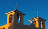 Golden glow of sunset on church bell towers