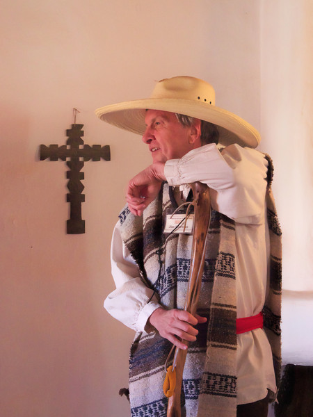 Volunteer in period costume at Rancho de los Gandrios, a living history museum depicting life on an old Spanish-American ranch