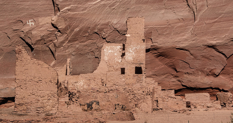 White House ruins with Anasazi pictograph painted on wall.  The swastika pre-dated Nazism by hundreds, if not thousands, of years.  It was commonly used in Eastern religions, and, known as the Whirling Log, was a good luck symbol for ancient Indian tribes.