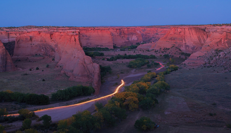 Navajo live at the base of the canyon.  A trail of head lighs and tail lights marks the way home.