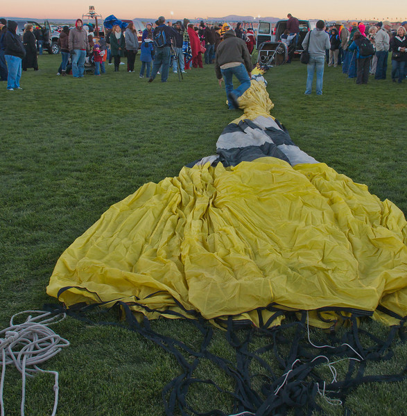 Laying a balloon out in preparation for inflation.