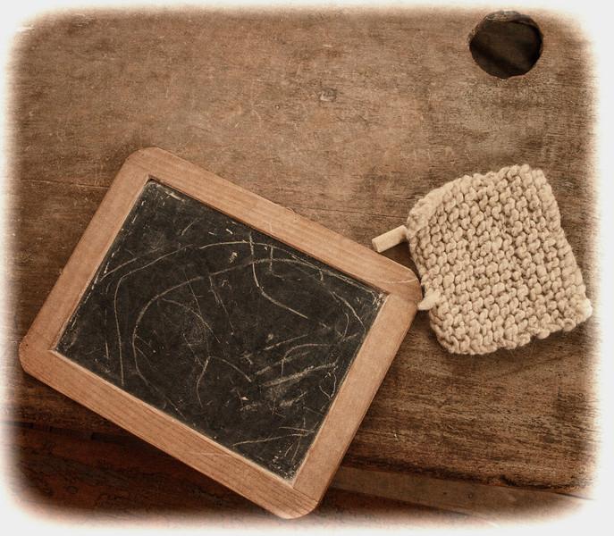 Chalk board and eraser on wooden desk