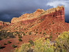 Richness of the red rocks mixed with sun and storm clouds