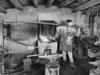 Blacksmith stoking fire