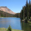 """Lake De Nolda, which had signs proclaiming it a """"Private Lake--No Trespassing."""" We would have stopped and trespassed, but it was too buggy."""
