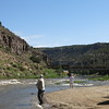 People fishing in the canyon of the Rio Grande.