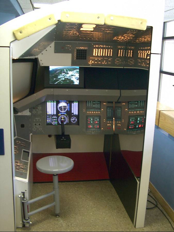 h) The space shuttle landing simulator was fun. Of course I tried to do that cool shuttle landing that Tommy Lee Jones did in the Space Cowboy's movie. Boy did the alarms go off.