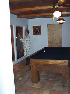 Ma in her pajamas tries to enlist someone to play pool with her. She became a real HUSTLER after a week of practice!
