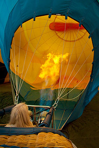 The balloon starts to rise with hot air.