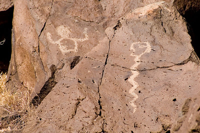 Petroglyph National Monument stretches 17 miles along Albuquerque's West Mesa. For 12,000 years man has been leaving traces in this area. During at least the last 2,500 years, these traces include petroglyphs, or images carved in stone, still visible today. Snake & Man Rinconada Canyon