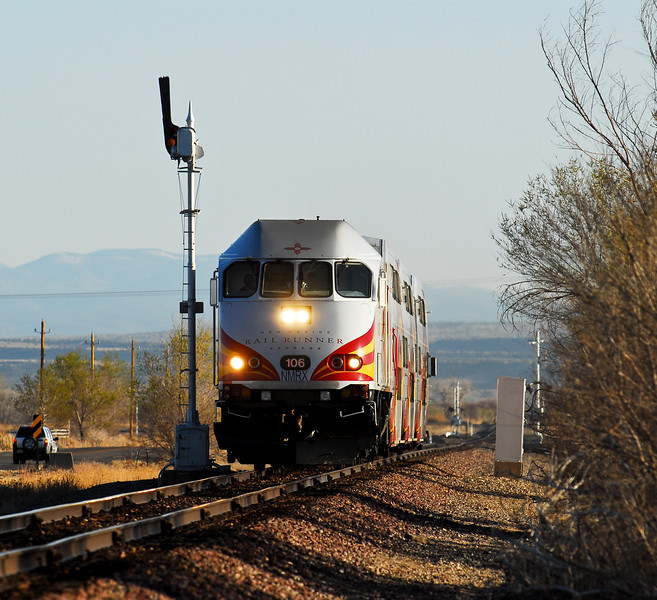 A southbound Railrunner passes former Santa Fe Semaphore signal 8902 just south of Bernalillo New Mexico.