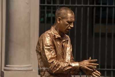 A bronze street performer posing in New Orleans.