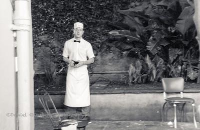 Worker at Cafe Du Monde in New Orleans taking a cigarette break.